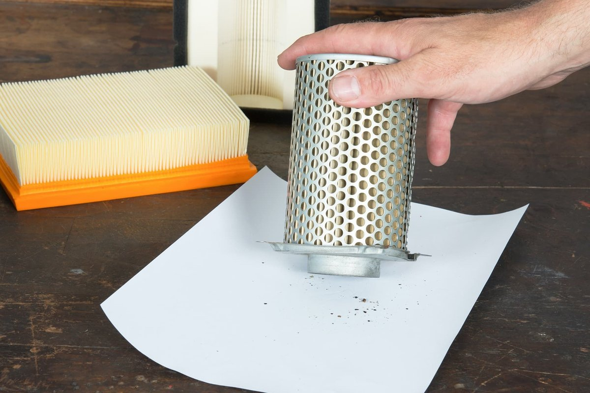 Carefully tapping out a paper air filter