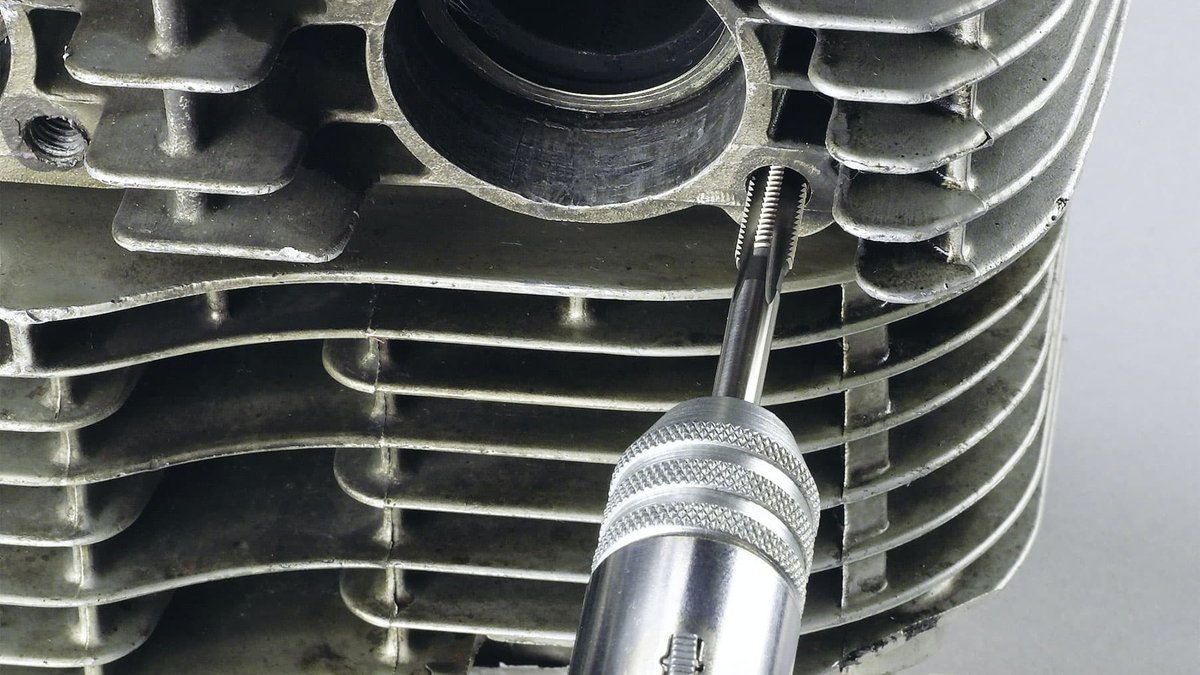 … cut thread for V-Coil repair insert …
