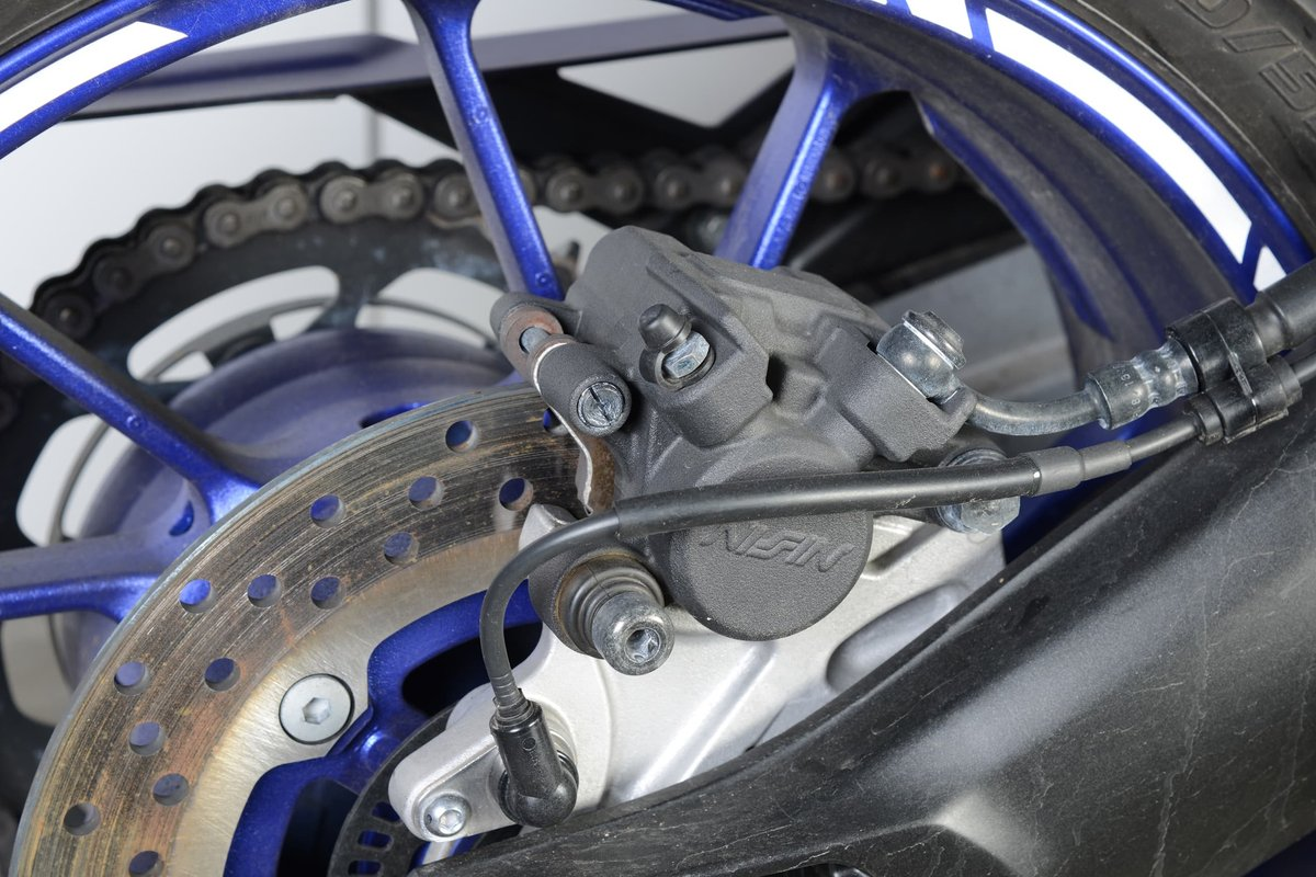 Simple floating caliper brakes are entirely sufficient for the rear wheel