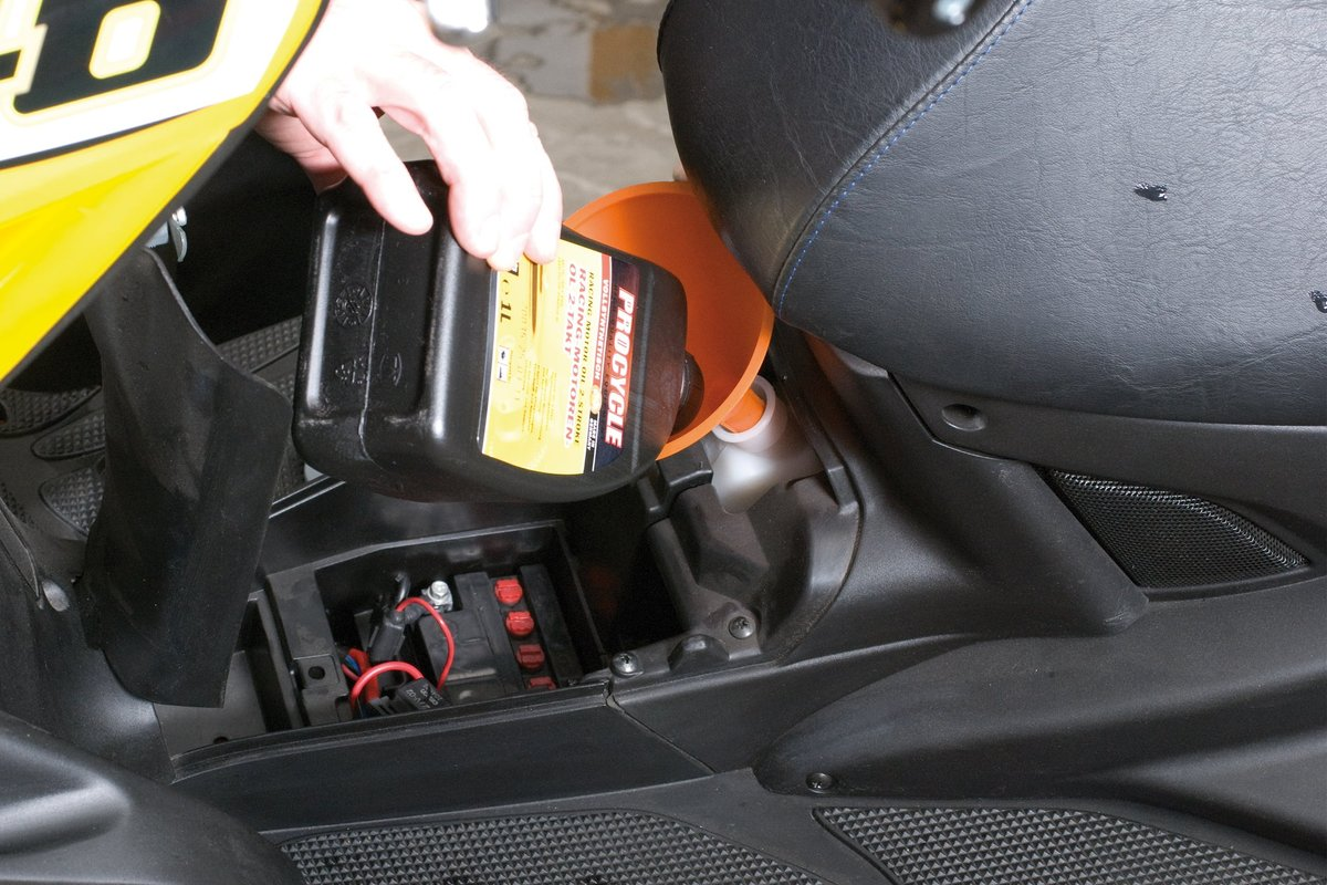 Step 6: Don't forget to regularly top up two-stroke oil
