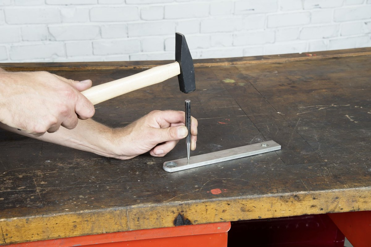 Step 1 – Mark the centre of the hole with a centre punch