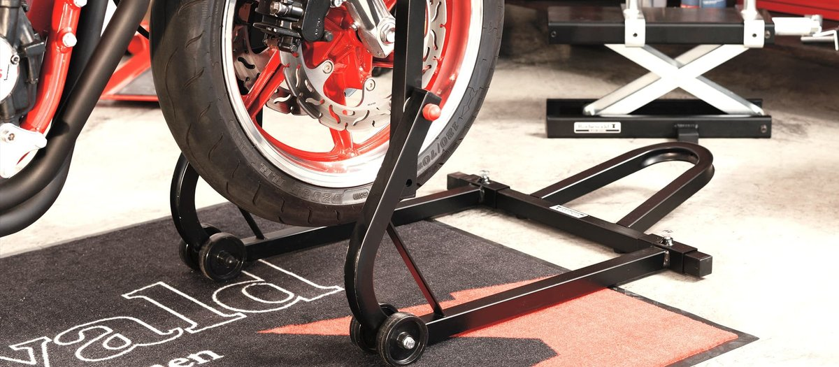 Jacking up the motorcycle with paddock stands