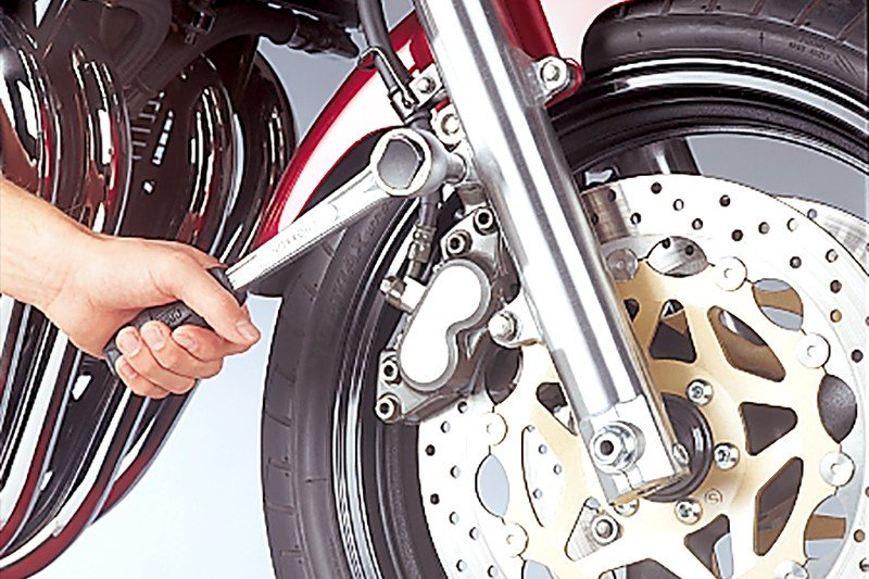 Step 2: Remove brake caliper