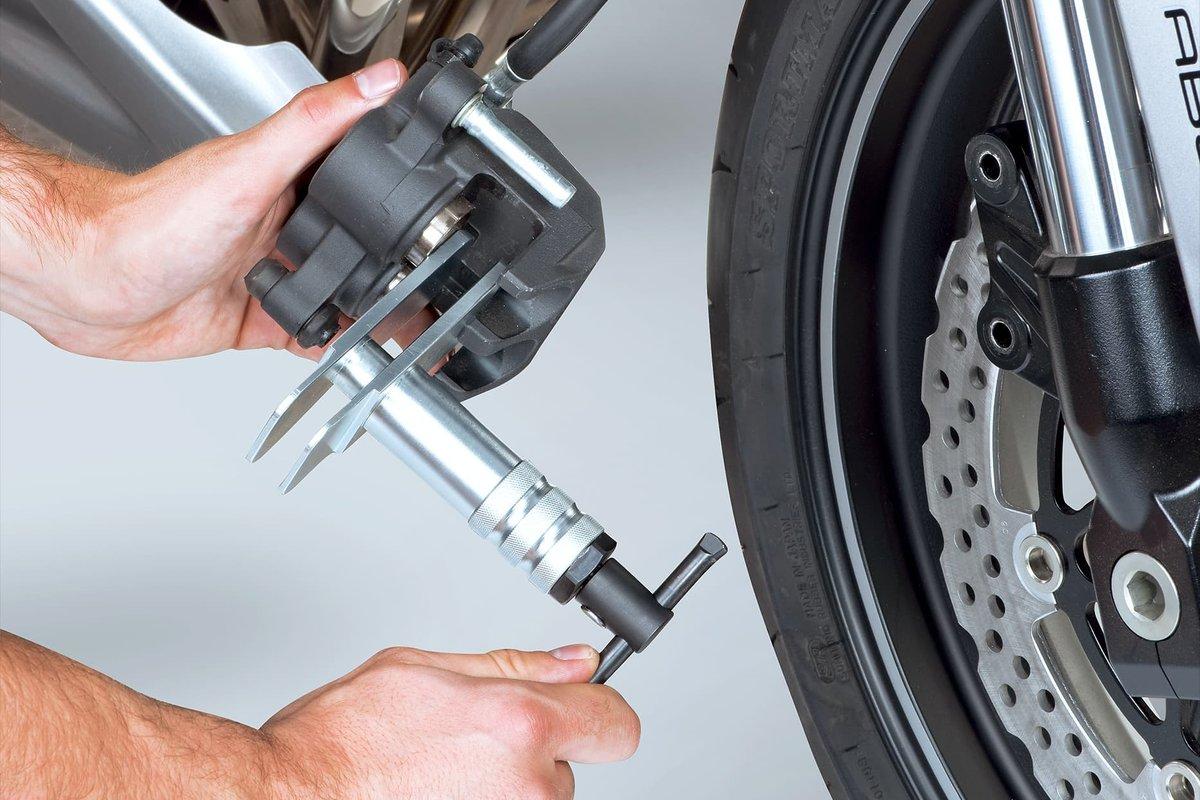 Step 5: Push back brake piston