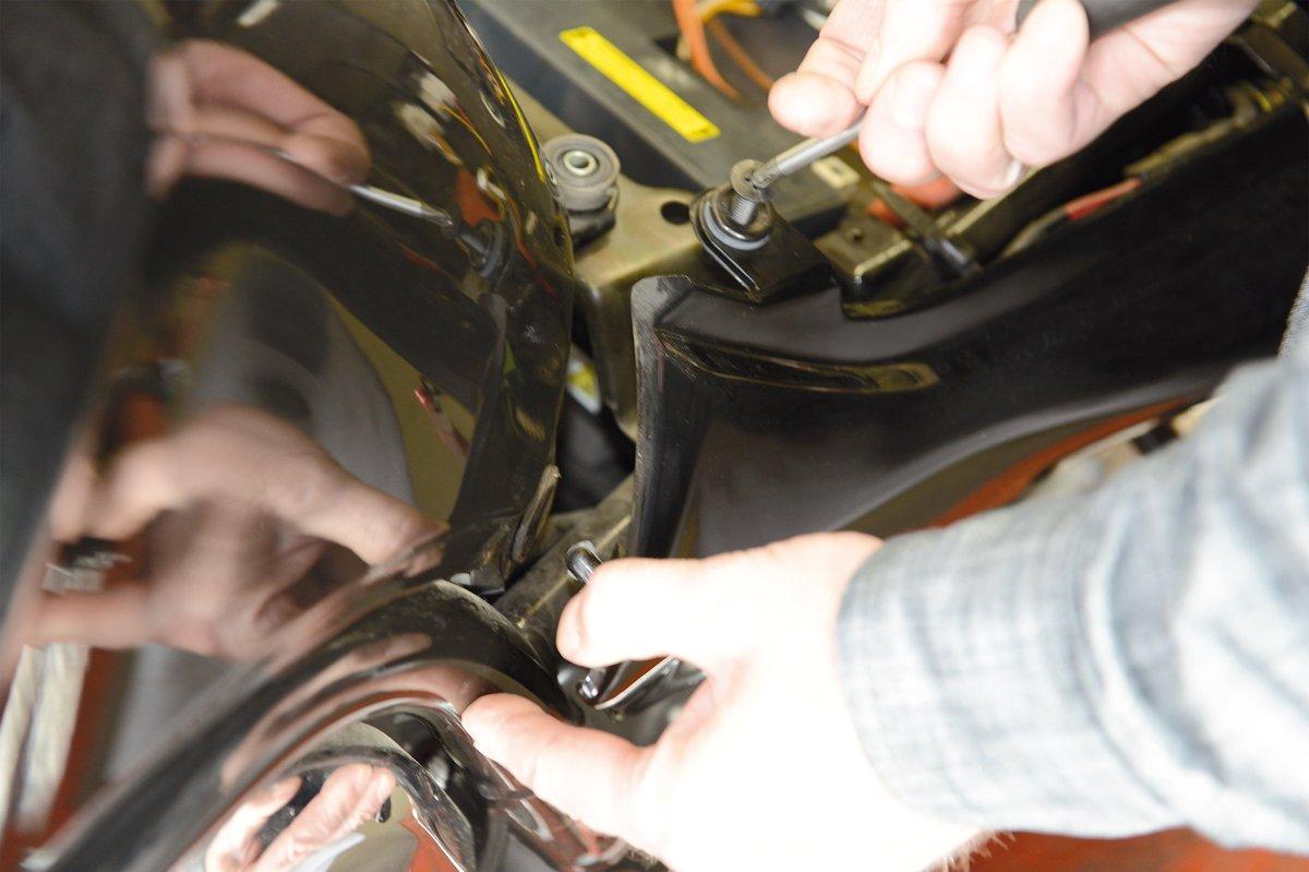 Step 6: Remove tank, undo side cover