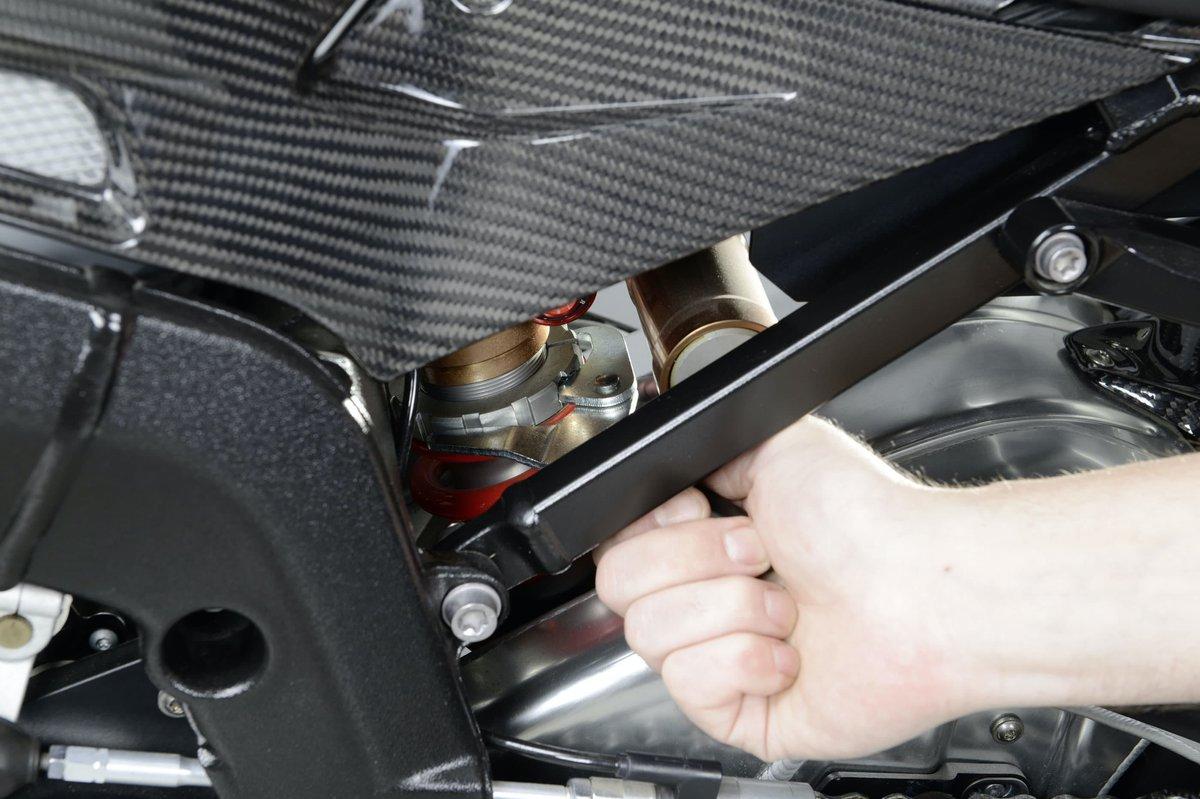 Step 2 b – Adjust shock preload using a hook wrench